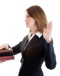 image of woman swearing on stack of bibles